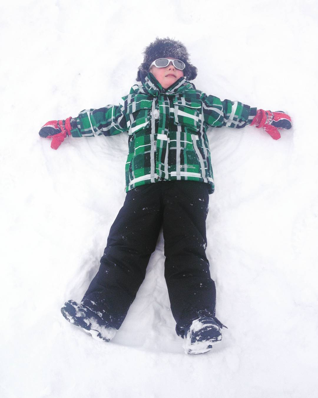 Snow angels!!  We love playing in the snow andhellip